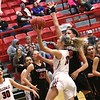Phoenix special photo by John Hasler<br /> Hilldale's Lacey Bell scores in front of the Verdigris defense during Tuesday's game at the Hilldale Event Center. Hilldale lost 71-40.