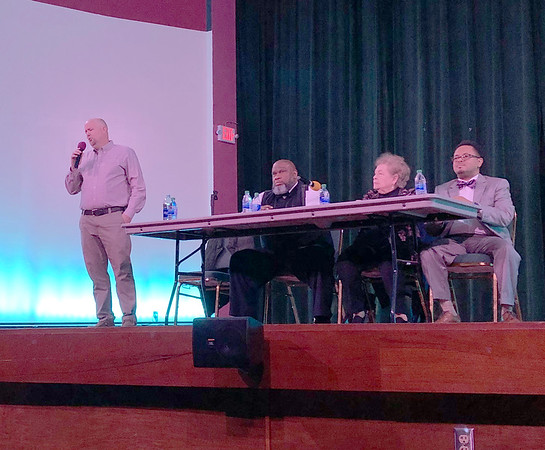 D.E. SMOOT/Muskogee Phoenix<br /> Mayoral contender Wayne Divelbiss, left, fields a question Thursday night during a forum at the Roxy Theater. Seated to his right, from left, are candidates Tracy Cole, Mayor Janey Cagle-Boydston and Ward IV Councilor Marlon Coleman.