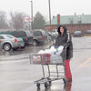 CATHY SPAULDING/Muskogee Phoenix<br /> Kimberly Stout of Muskogee pushes her grocery cart through Thursday's rain. She said she was stocking up for cold weather. People willing to get outside on Thursday had to muddle through a chilling rain. Warmer, drier weather is expected Friday and through the weekend, according to Muskogee's AccuWeather website.