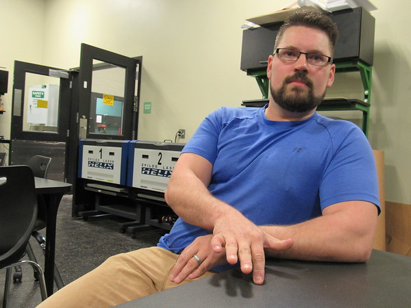 """CATHY SPAULDING/Muskogee Phoenix<br /> Muskogee High School's new Fab Lab manager Collin McCawley says the lab allows people to """"do cool stuff and accidentally learn something."""""""