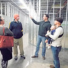 KENTON BROOKS/Muskogee Phoenix<br /> Pastor Micah Wisdom, second from right, points out aspects of the new church building for the United Pentecostal Church in Wagoner to church members Kristin Qualls and Mark Qualls as well as Rick Campbell with son Baker. The Qualls were among the members who took a tour of the church earlier this week. The church building is in the old Fred's Discount Store at 700 E. Cherokee St.