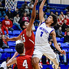 CHRIS CUMMINGS/Phoenix Special Photo<br /> Checotah's Brenden Dan goes high to score over Stilwell's Jorge Bautista and Cayden Lee in action Friday at the Checotah Event Center. The Wildcats won both the boys and girls game as the post-holiday portion of the high school basketball schedule began Friday. More in roundup, Page 2