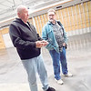 KENTON BROOKS/Muskogee Phoenix<br /> Garry Moore, left, talks with James Honeycutt inside the building that will be the United Pentecostal Church in Wagoner. Moore is helping build the church, and Honeycutt is a church member who toured the new facility earlier this week. Pastor Micah Wisdom said the goal to open the new church is the first of June.