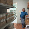 CATHY SPAULDING/Muskogee Phoenix<br /> Surplus canned food line shelves at Joseph's Storehouse. Director Mary Juarez said a lot of the canned food was surplus donations from late May floods.