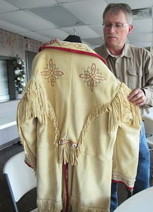 CATHY SPAULDING/Muskogee Phoenix Tom Roberts shows the fringe and embroidery work he did on a buckskin jacket he wears when he portrays 19th Century naturalist Samuel Washington Woodhouse.