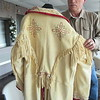 CATHY SPAULDING/Muskogee Phoenix<br /> Tom Roberts shows the fringe and embroidery work he did on a buckskin jacket he wears when he portrays 19th Century naturalist Samuel Washington Woodhouse.