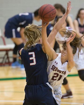 Phoenix special photo by Von Castor<br /> Sequoyah's Alexys Keys is fouled by HSAA's Anna Moss on Saturday in the Large School girls final of the Bedouin Shrine Classic at the Muskogee Civic Center. Keys would make the shot as the Lady Indians won 65-52.