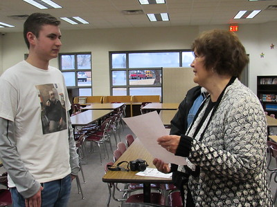 CATHY SPAULDING/Muskogee Phoenix Fort Gibson High sophomore Kinley Wilson visits with Sandi Stafford, president of the auxiliary for Veterans of Foreign Wars post 474, after he won the Post's and District Voice of Democracy audio-essay contest.