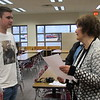 CATHY SPAULDING/Muskogee Phoenix<br /> Fort Gibson High sophomore Kinley Wilson visits with Sandi Stafford, president of the auxiliary for Veterans of Foreign Wars post 474, after he won the Post's and District Voice of Democracy audio-essay contest.