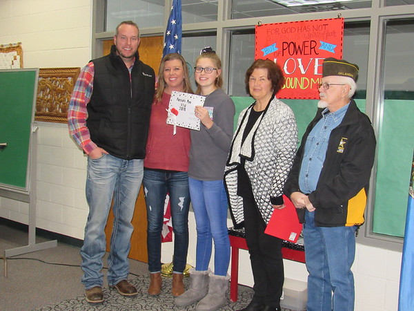 CATHY SPAULDING/Muskogee Phoenix<br /> <br /> Fort Gibson eighth-grader Linzi Foutch stands with her parents, from left, Brandan and Melissa Foutch and, from right Veterans of Foreign Wars Post 474 Commander Dennis Morton and Post Auxiliary President Sandi Stafford. Linzi placed first in the VFW's post and district Patriot's Pen essay contest.