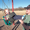 CATHY SPAULDING/Muskogee Phoenix<br /> Orion McCrery, 1, swings up to his father, Mathew McCrery during a visit to Robison Park. McCrery said Tuesday was his son's first birthday. Sunny skies brought people of all ages to Robison Park. The rest of the week could be warm and windy with a chance of rain Thursday and Friday, according to AccuWeather. Temperatures could drop on Saturday.