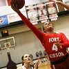 Phoenix special photo by John Hasler<br /> Fort Gibson's Alexis Wright, right, lays up a shot in front of Sequoyah's Alexys Keys during Monday's game. The 4A No. 2 Lady Tigers defeated the 3A No. 1 Lady Indians 42-32.