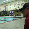 Staff photo by Cathy Spaulding<br /> Bub Rowan watches people swim laps at Fort Gibson school pool. He eschews lifeguard pay to help raise money for the swim team.