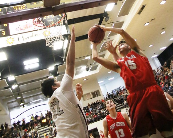 Phoenix special photo by John Hasler<br /> Fort Gibson's Chance Wofford, center, watches as teammate Seth Martin, right, scores on Sequoyah's Adam Saine during Monday's battle in The Place Where They Play. The Class 4A No. 3 Tigers beat the 3A No. 5 Indians 64-58.