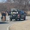 CHESLEY OXENDINE/Muskogee Phoenix<br /> Oklahoma Highway Patrol's Bomb Squad, joined by agents from the Bureau of Alcohol, Tobacco, Firearms and Explosives, gather their gear after recovering a small explosive device from a car near U.S. 62 Wednesday morning.