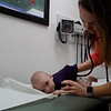 Staff photo by Mike Elswick<br /> Cherokee Nation Three Rivers Medical Center's Amy Ceselski, a pediatric nurse practitioner, is seen Tuesday conducting an exam on Creed, the 2-month old son of Lisa and John Lamont of Muskogee. She said regular checkups with a medical professional are recommended to ensure children are developing appropriately.