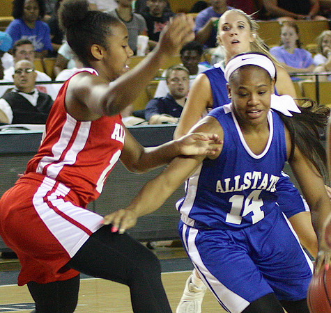 Phoenix special photos by Von Castor<br /> Muskogee's Trena Mims (red) battle in All-State action Wednesday at the Mabee Center.