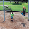 Staff photo by Cathy Spaulding<br /> Brothers, from left, John Michael Webber, 9, and Javian Webber, 10, challenge each other while swinging.
