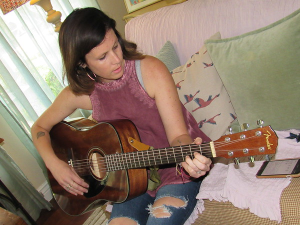 CATHY SPAULDING/Muskogee Phoenix<br /> Hillary McQueen says she learned to play guitar by watching YouTube videos. She said her goal was to learn to play by the time she turned 30.