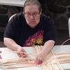 Staff photo by Mark Hughes<br /> Tahlequah resident Pat Weber uses flat reeds to make a basket Saturday at the Cherokee Heritage Center at Park Hill. Weber said she was not raised in her Cherokee culture and she is trying to get in touch with that.