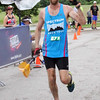 Special photo by John Hasler<br /> Jonathan Garner crosses the finish line of the Port to Fort run Saturday.