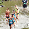 Special photo by John Hasler<br /> Jodi Glover of Fort Gibson leads her team on the short course adventure race of the Port to Fort event Saturday.