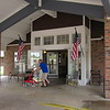 CATHY SPAULDING/Muskogee Phoenix<br /> A man walks past the open entrance at Dogwood Creek assisted living center on Monday afternoon. All entrance doors were open because the air conditioner had stopped working on Saturday.