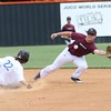 Phoenix special photo by John Hasler<br /> Oklahoma Naturals second baseman Tyler Brown stretches for a throw as Oklahoma Expos' Tyler Lindley steals second in the championship game of the Connors Showcase on Sunday.