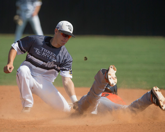 Phoenix special photo by Von Castor<br /> Three Rivers' Ben Replogle  applies the tag to a Coweta base runner Sunday morning at Hilldale High School during play in the Rusty Fulps Memorial Tournament.