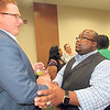 CATHY SPAULDING/Muskogee Phoenix<br /> New Muskogee Public Schools Superintendent Jarod Mendenhall, left, visits with the Rev. Rodger Cutler, pastor of St. Mark Baptist Church, during a reception for Mendenhall.