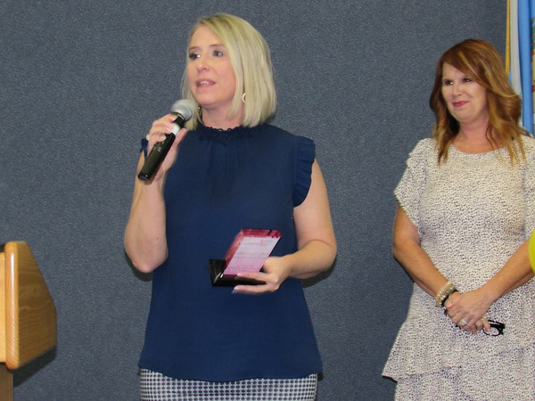 CATHY SPAULDING/Muskogee Phoenix<br /> Real estate agent and columnist Holly Rosser Miller accepts the Spirit of Excellence Award at the Greater Muskogee Area Chamber of Commerce and Tourism's Women's Leadership Conference, held Wednesday at Indian Capital Technology Center.