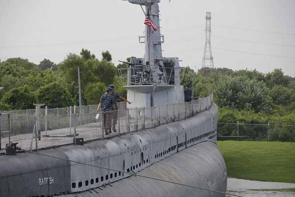 Staff photo by Harrison Grimwood<br /> U.S. Naval Sea Cadets survey the area around the USS Batfish before starting their stint on the submarine.