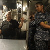 Staff photo by Harrison Grimwood<br /> U.S. Naval Sea Cadet Immanuel Chrisp listens to retired Lt. Cmdr. Thomas Snodgrass explain how orders are given and received among the crew members on a submarine.