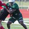 Phoenix special photo by Von Castor<br /> Muskogee's Michael Edwards beats a block by a Prague lineman during Muskogee's team camp on Tuesday.