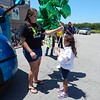 Staff photo by Wendy Burton<br /> Amanda Berry, left, helps her daughter McKinleigh Berry with a big bunch of balloons she was presented after riding from Muskogee to Wagoner in the Wal-Mart Heart truck convoy. McKinleigh was made an honorary truck driver for the day, was greeted by lots of friends, family, and Wagoner Wal-Mart employees and enjoyed pizza and cake to top off her special day.