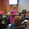 Staff photo by Mike Elswick<br /> Greater Muskogee Area Chamber of Commerce President and Chief Executive Officer D.J. Thompson passes out papers seeking feedback on a session of the Women's Leadership Conference on Wednesday.