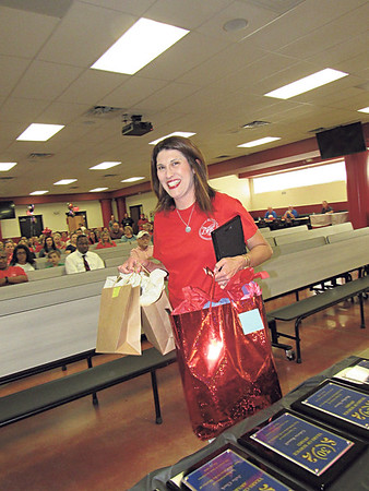 CATHY SPAULDING/Muskogee Phoenix<br /> Hilldale Elementary teacher Jenny Morphis carries gift bags after being honored as Hilldale Teacher of the Year in May. On Thursday, she was named a finalist for Oklahoma Teacher of the Year.