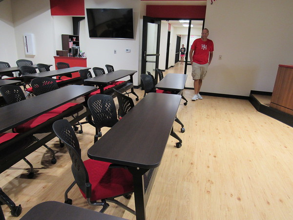 CATHY SPAULDING/Muskogee Phoenix<br /> <br /> Hilldale School Superintendent Erik Puckett walks past new tables and chairs inside the new administration building's meeting room. He said the room, a former church sanctuary, will be used for board of education meetings and faculty professional development sessions