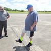 CHESLEY OXENDINE/Muskogee Phoenix<br /> Rick Crofford attempts to stand on one leg during a sobriety test Friday morning. The test occurred during Driver Impairment Awareness Day held at Muskogee-Davis Regional Airport.
