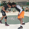 JOHN HASLER/Phoenix Special Photo<br /> Jacobe Smith, right, and Dawaylon Barnes, both former Muskogee High, JUCO teammates and Big 12 wrestlers, demonstrate for kids attending their weekend camp Friday at Muskogee High.