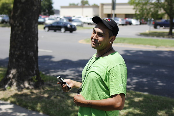 Staff photo by Harrison Grimwood<br /> Elijah Harjo gives a big smile while searching Spaulding Park for Pokemon on Wednesday afternoon.