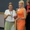 Staff photo by Cathy Spaulding<br /> Andrea Wilcoxen, left, EASTAR Health System's director of volunteer services, accepts a Spirit of Excellence Award from D.J. Thompson, president and chief executive officer of Greater Muskogee Area Chamber of Commerce, on Wednesday during the Chamber's Women's Leadership Conference.