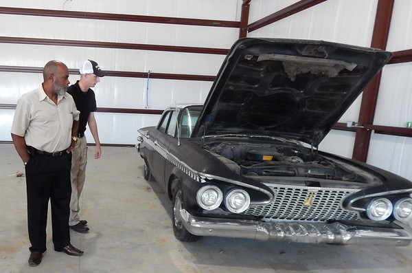 Staff photo by Wendy Burton<br /> City Councilor Ivory Vann, left, and Community Resource Officer Brandon Garner check out the 1961 Plymouth Fury local business owners purchased to restore and donate to the city for parades and other community events.