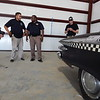 Staff photo by Wendy Burton<br /> Cruis'n Angels Car Club President Gary Thompson, left, and Community Resource Officer Brandon Garner, right, take photos of a 1961 Plymouth Fury bought by donors for restoration as a parade or event entry for the city. Community Resource Officer Josh Garza, second from left, and Deputy Chief Reggie Cotton visited Morgan Towing on Thursday to check out the newly acquired car.