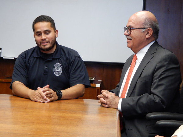 Staff photo by Wendy Burton<br /> Community Resource Officer Josh Garza, left, and Rodolfo Quilantan Arenas, the Consul de Mexico at the consulate in Little Rock, Arkansas, met recently to talk about an upcoming event the Muskogee Police Department is hosting to help build a better relationship with Muskogee's Hispanic community. Officials say Garza's work is<br /> making big strides toward improving law enforcement's relationship with Hispanics.