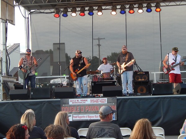 Mason Jar Revival performs on stage at the Switch Monkey Music Festival on North Main Street in Wagoner. The band members include, from left, Chad Cox, Jon Washington, Jeremy Jones, Bud Doyle and Russ Jones.