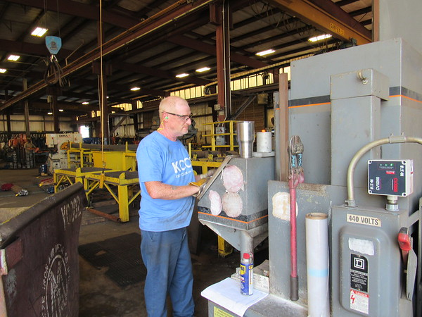 KENTON BROOKS/Muskogee Phoenix<br /> Jeff Wert works with a hydraulic band saw while wearing safety glasses as part of his job at Eastpointe Industries in Muskogee. Eye protection can range from the glasses to shields to protect the eyes while working.