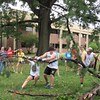 Staff photo by Cathy Spaulding<br /> Rachel Watson and Danny Klapp pull at a massive branch that had fallen on the Bacone College campus. The two were part of a youth volunteer group from Mattoon, Ill., who helped clean debris from a Thursday storm.