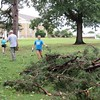 Staff photo by Cathy Spaulding<br /> Volunteers from an Illinois youth group add debris to a growing pile on Bacone College's lawn.