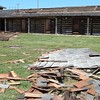 Staff photo by Mark Hughes<br /> Large portions of cedar shake shingles lie in the courtyard at the historic Fort Gibson stockade after high winds and rain tore through the area.